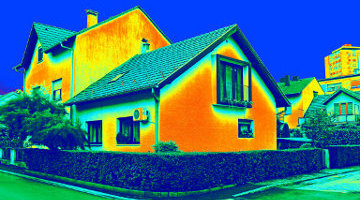 Infrared thermovision image of building showing heat loss